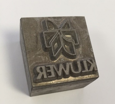 "This ""die-cut"" was a specially made (and expensive) metal stamp, used to emboss paper! The designer usually owned the die-cut and sent it to the printer to use on the final product."