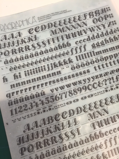 This fancy stuff is called Letraset. The letters could be rubbed off onto paper one by one, but it had to be done right or parts of the letter wouldn't stick and the image would be ruined!